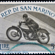 Stock Photo: SAN MARINO - CIRC1954: stamp printed in SMarino shows image of Motorbike race, circ1954