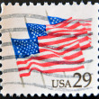 UNITED STATES OF AMERICA - CIRCA 1981: a stamp printed in USA shows US Flags on Parade, circa 1981 — Stock Photo