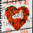 Stock Photo: UNITED STATES OF AMERICA - CIRCA 1994: A stamp printed in USA shows dove and a love heart made of roses, circa 1994