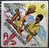 BURUNDI - CIRCA 1967: A stamp printed in Burundi shows two boy scouts, circa 1967 — Foto de Stock