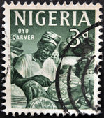 NIGERIA - CIRCA 1961: A stamp printed in Nigeria shows Oyo carver, circa 1961 — Stock Photo