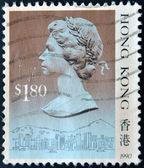 Hong kong - circa 1990: een stempel gedrukt in hong kong toont koningin elizabeth ii, circa 1990 — Stockfoto