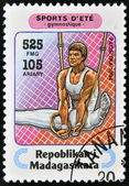 MADAGASCAR - CIRCA 1994: A stamp printed in Madagascar dedicated to summer sports shows Rings (gymnastics), circa 1994 — Photo