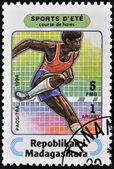 MADAGASCAR - CIRCA 1994: A stamp printed in Madagascar dedicated to summer sports shows Steeplechase, circa 1994 — Stock Photo