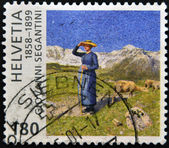 SWITZERLAND - CIRCA 1999: A stamp printed in Switzerland shows Midday in the Alps, by Giovanni Segantini, circa 1999 — Stock Photo