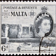 Stock Photo: MALT- CIRC1956: stamp printed in Maltshows Neolithic temple of Ggantijin Gozo, Malta, circ1956