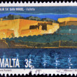 图库照片: MALT- CIRC1991: stamp printed in Maltshows St. Michael Bastion, Valletta, circ1991