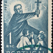 PORTUGAL - CIRCA 1952: stamp printed in Portugal shows Saint Francis Xavier holding a cross and blessing two children, circa 1952. — Stock Photo