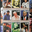 TAJIKISTAN - CIRCA 2000: Collection stamps dedicated to icons of the millenium, shows Elvis Presley, Marilyn Monroe, Neil Armstrong, Tiger Woods, Frank Sinatra, Bill Clinton, Bruce Lee, Albert Einstei — Stock Photo #11245285