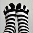 Two feet in stockings black and white striped — Photo