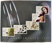 Alemanha - circa 2001: mostra de selos de coleção impressos na alemanha, dedicado ao cinema, greta garbo, jean gabin, marilyn monroe, charles chaplin e rolo de filme, por volta de 2001 — Fotografia Stock