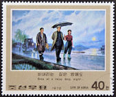 NORTH KOREA - CIRCA 1976: A stamp printed in DPR KOREA shows image of korean, Even at a rainy deep night..., circa 1976 — Stock Photo