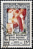 FRANCE - CIRCA 1951: A stamp printed in France shows Saint Nicholas, the French national museum of imagery, circa 1951 — Stock Photo