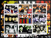KIRZIGUISTAN - CIRCA 2001: Collection stamps printed in Kirziguistan shows the Beatles, circa 2001 — Stock Photo