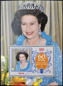 NEVIS - CIRCA 1986: a stamp printed in Nevis shows Her Majesty the Queen Elizabeth II, sixtieth birthday, circa 1986 — Stock Photo