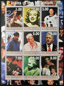 TAJIKISTAN - CIRCA 2000: Collection stamps dedicated to icons of the millenium, shows Elvis Presley, Marilyn Monroe, Neil Armstrong, Tiger Woods, Frank Sinatra, Bill Clinton, Bruce Lee, Albert Einstei — Stock Photo