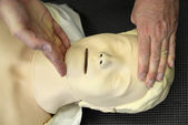 Resuscitation training on dummy — Stock Photo