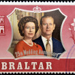 Постер, плакат: GIBRALTAR CIRCA 1972: A stamp printed in Gibraltar shows portrait of the Duke of Edinburgh and Queen Elizabeth II commemoracion of its silver wedding circa 1972