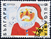 BULGARIA - CIRCA 1992: A stamp printed in Bulgaria shows to drawing of Christmas, Santa Claus , circa 1992. — Zdjęcie stockowe