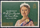 GIBRALTAR - CIRCA 1980: A stamp printed in Gibraltar shows portrait of the Queen Elizabeth commemorates the 80th birthday of the Queen Mother, circa 1980 — Foto Stock