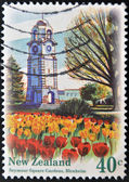 NEW ZEALAND - CIRCA 1996: A stamp printed in New Zealand shows Clock Tower in Seymour Square Tower Blenheim, circa 1996 — 图库照片