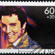 GERMANY - CIRCA 1988: A stamp printed in Germany shows image portrait of famous American singer Elvis Presley, circa 1988. - Foto de Stock  