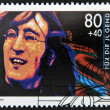 GERMANY - CIRC1988: stamp printed in Germany shows image of John Lennon, circ1988 — Stock Photo #11611217