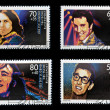 Stock Photo: GERMANY - CIRC1988: Collection stamps printed in Germany dedicated to rock and roll, shows John Lennon, Jim Morrison, Elvis Presley and Buddy Holly, circ1988