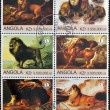 Royalty-Free Stock Photo: ANGOLA - CIRCA 2000: A collection of stamps printed in Angola shows a scenes from the life of lions, circa 2000.