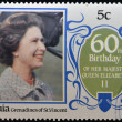 BEQUI- CIRC1986: stamp printed in Grenadines of St. Vincent celebrating 60th birthday of her majesty Queen Elizabeth II, circ1986 — Stock Photo #11611353