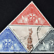 SPAIN - CIRCA 1992: Collection stamps shows Columbus monument and the three calaveras, circa 1992 - Foto de Stock  