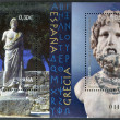 SPAIN - CIRCA 2007: A stamp printed in Spain shows a sculpture and bust of the god Asclepius mythological Ampurias Museum and the Museum of Athens circa 2007 - Stock Photo