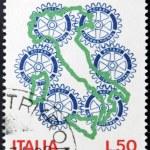 ITALY - CIRCA 1973: a stamp printed in Italy shows Rotary Emblem, 50 anniversary of Rotary International Italian, circa 1973 — Stock Photo #11611432