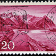 LIECHTENSTEIN - CIRCA 1959: A stamp printed in  Liechtenstein, shows a Mountain landscape from Lake Constance, circa 1959 - Stock Photo