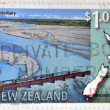 NEW ZEALAND - CIRCA 1997: A stamp printed in New Zealand shows a railway line that connects Invercargill and Christchurch, circa 1997 — Stock Photo