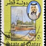QATAR - CIRCA 1984: A stamp printed in Qatar shows a portrait of Sheikh Khalifa bin Hamed Al-Thani and landscape with boat, circa 1984 — Stock Photo #11611549