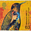 Stock Photo: UNITED KINGDOM- CIRC1999: stamp printed in Great Britain shows Artistic Representation of bird and migration to Uk, commemoration of second millennium, circ1999
