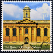 Royalty-Free Stock Photo: UNITED KINGDOM - CIRCA 2012: A stamp printed in Great Britain shows The Queen&#039;s College Oxford, circa 2012