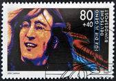 GERMANY - CIRCA 1988: A stamp printed in Germany shows image of John Lennon, circa 1988 — Stock Photo