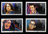 GERMANY - CIRCA 1988: Collection stamps printed in Germany dedicated to rock and roll, shows John Lennon, Jim Morrison, Elvis Presley and Buddy Holly, circa 1988 — Stock Photo