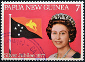 PAPUA NEW GUINEA - CIRCA 1977: stamp printed in Papua New Guinea shows a portrait elizabeth II, silver jubilee in commemoration, circa 1977 — Stock Photo