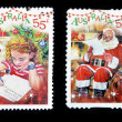 AUSTRALIA - CIRCA 2010 Two stamps printed in Australia shows Girl writing letter to Santa Claus and Santa Claus reading the letter, circa 2010 — Stock Photo