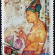 Stock Photo: EQUATORIAL GUINE- CIRC1974: stamp printed in Equatorial Guinededicated to female nude in art history shows golden-skinned young of Indiart, circ1974