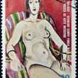 EQUATORIAL GUINEA - CIRCA 1974: A stamp printed in Guinea dedicated to the female nude in art history shows Nude on a red background of Henri Matisse, circa 1974 — Stock fotografie