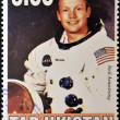 Stock Photo: TAJIKISTAN - CIRC2000: stamp printed in Tajikistshows Neil Armstrong, circ2000