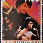 TAJIKISTAN - CIRCA 2000: A stamp printed in Tajikistan shows Bruce Lee and Jackie Chan, circa 2000 — Stock Photo