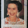 UNION IS. - CIRCA 1986: a stamp printed in the Grenadines of St. Vincent shows Her Majesty the Queen Elizabeth II, sixtieth birthday, circa 1986 - Stok fotoğraf