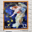 UNITED STATES OF AMERICA - CIRCA 1995: A stamp printed in USA shows midnight angel, holiday, circa 1995 — Stock Photo