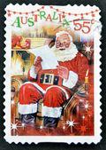 AUSTRALIA - CIRCA 2010: A stamp printed in Australia shows Santa Claus reading the letter, circa 2010 — Stock Photo