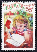 AUSTRALIA - CIRCA 2010: A stamp printed in Australia shows Girl writing letter to Santa Claus, circa 2010 — Photo